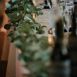 Artificial Eucalyptus - Burlap Runners - Gold Mercury Votive Candle Holders - Photo Credit - Erica Steinhouse Photography